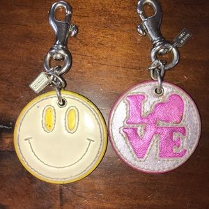 Two Coach bag charms
